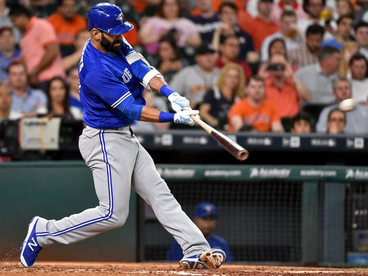 FILE - In this Aug. 2, 2016, file photo, Toronto Blue Jays' Jose Bautista hits a solo home run, the 300th home run of his career, career off Houston Astros starting pitcher Lance McCullers in the third inning of a baseball game, in Houston. Terms like launch angle and exit velocity are creeping into the baseball lexicon, and it's not just number crunchers jumping on board. The successes of Josh Donaldson, Bautista and Kris Bryant are changing the way hitters and coaches think about the swing. (AP Photo/Eric Christian Smith, File)