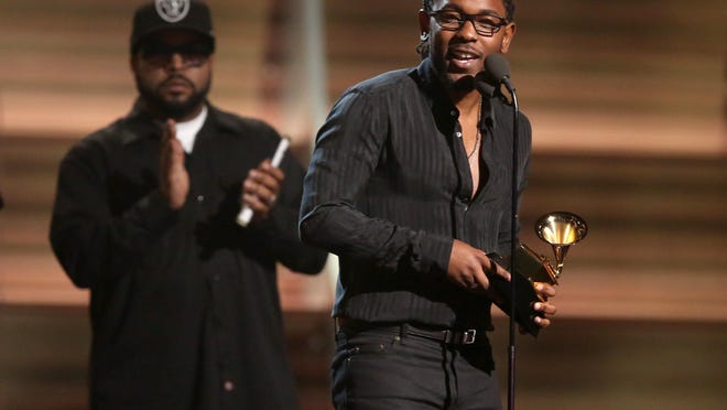 """Kendrick Lamar accepts the award for best rap album for """"To Pimp A Butterfly"""" at the 58th annual Grammy Awards on Monday, Feb. 15, 2016, in Los Angeles."""