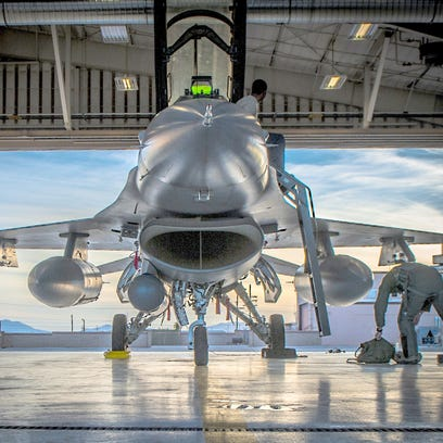 An F-16 Fighting Falcon sits in a hangar prior to departure at Holloman Air Force Base near Alamogordo.