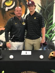 Wyly (right) stands with Neville baseball coach Paul