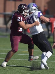 Earlham's Torrie Mayberry tackles Bluffton's Adam Duncan Saturday, Nov. 5, 2016 during a football game at Earlham College in Richmond.