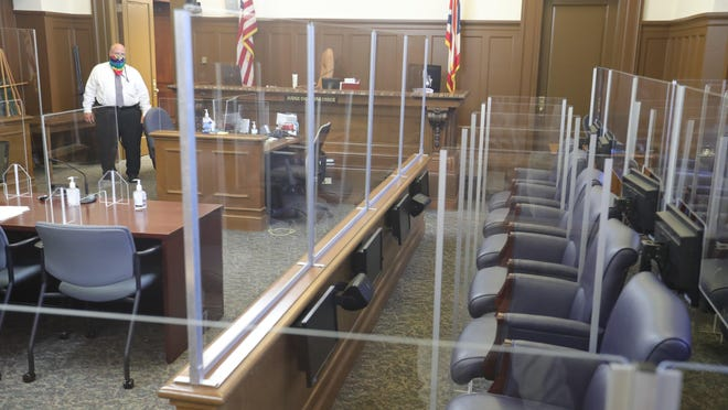 Plexiglass encloses the juror boxes in Judge Christine Croce's courtroom Monday in preparation of the continuation of the Stanley Ford trial in Akron.