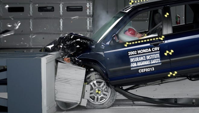 Photo from the Insurance Institute for Highway Safety shows a crash test of a 2002 Honda CR-V, one of the models now recalled in some states to repair faulty air bags.