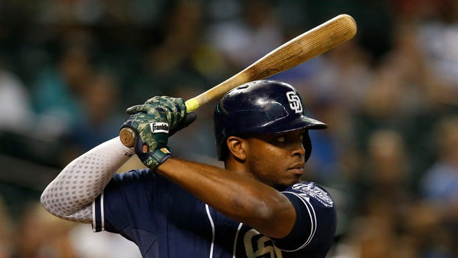 San Diego Padres left fielder Justin Upton (10) fields the ball against the Arizona Diamondbacks in the sixth inning during a baseball game, Tuesday, Sept. 15, 2015, in Phoenix.