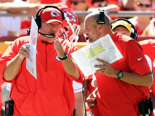Chiefs co-offensive coordinator Matt Nagy, right, talks to head coach Andy Reid on Aug. 13, 2016.