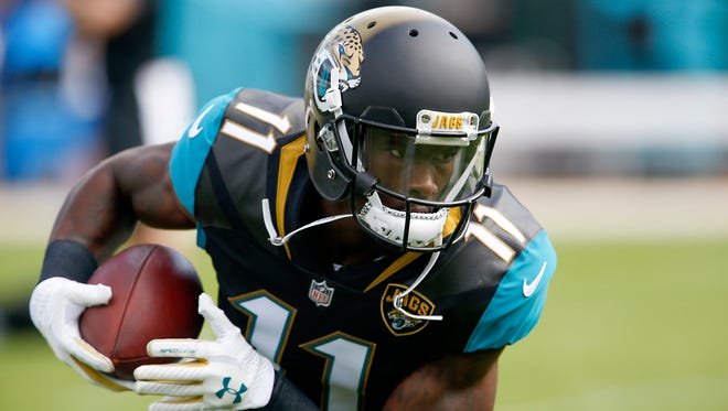Jacksonville Jaguars wide receiver Marqise Lee runs after catching a pass during pre game warmups before the game against the Indianapolis Colts at EverBank Field.