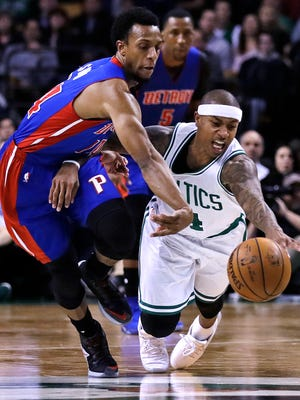 Celtics guard Isaiah Thomas, right, and Pistons guard Ish Smith battle for a loose ball during the second half of the Pistons' 113-109 loss Monday in Boston.