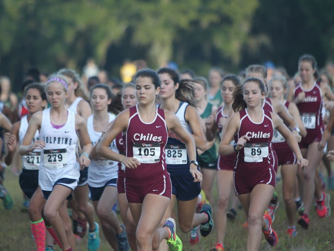 Girls runners take off at the start of the Cougar XC
