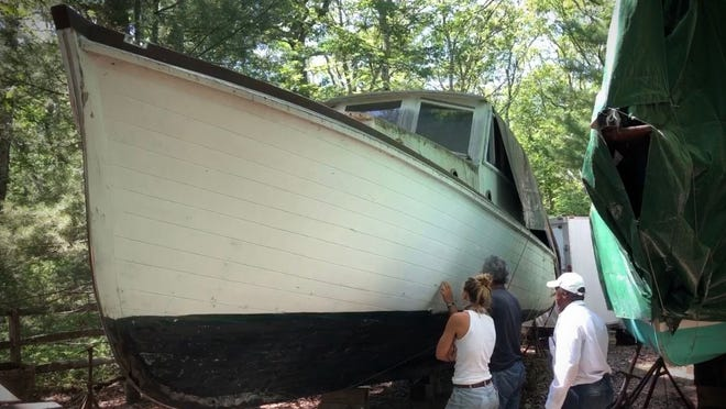 """Part of a boat that is being retrofitted in Vineyard  Haven to replicate the boat from the movie """"Jaws."""" A group of ocean lovers and movie buffs is building a replica of the boat, the Orca, for use as a conservation tool."""
