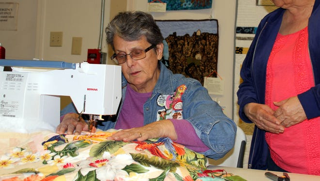 Nancy Costa demonstrates a zig-zag stitch for Anita Antillon. Costa is a member of the Deming Quilting B's. The club hosted its annual Trunk Show from March 9-12, at the Deming-Luna-Mimbres Museum.