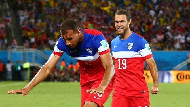 USA defender John Brooks (6) celebrates with Graham Zusi after scoring a second half goal against Ghana during the 2014 World Cup at Estadio das Dunas.