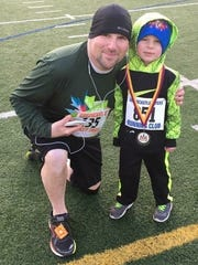 Mont Alto's Jeffrey Hein and son Jayce after completing the Greencastle Turkey Trot. It was Jeffrey's second showing at the event, while Jayce was a first-timer to the race.