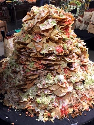 The 100-pound nachos mound for Super Bowl 51 at Market District.