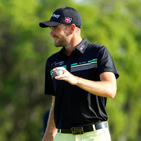 Troy Merritt reacts after completing play on the 18th