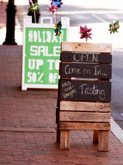 Downtown businesses advertise to shoppers in Staunton on Tuesday, Sept. 13, 2016.