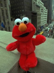 A giggling Tickle Me Elmo doll is photographed Wednesday,