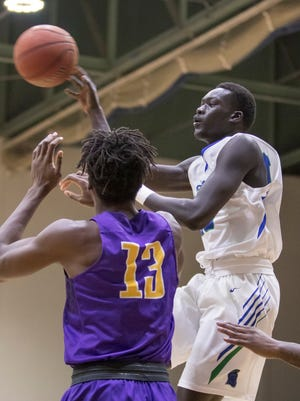 Moter Deng (10) passes the ball during the Montevallo vs UWF men's basketball game at the University of West Florida in Pensacola on Monday, December 18, 2017.