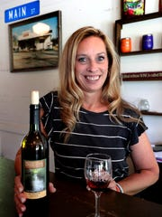 Candy Wence the owner of The Big Creek Winery Tasting Room, in Christiana, Tenn. shows off one of the wines for sale at her location, on Friday July 20 2018.