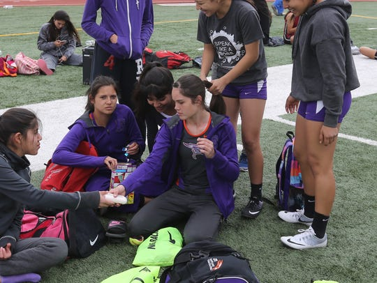 Hailey Black, center, and her Eastlake teammates wait