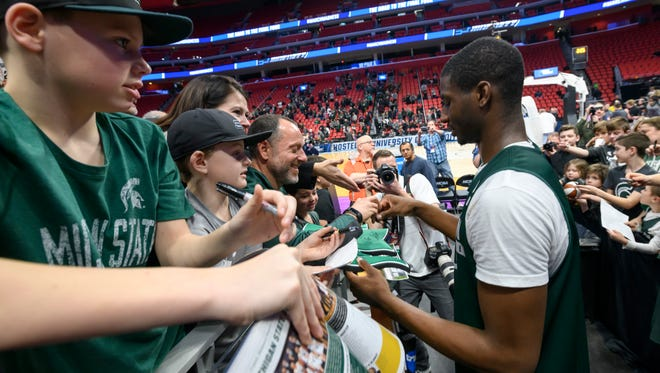 Michigan State's Jaren Jackson Jr. signs autographs for the fans after practice at Little Caesars Arena on Friday.
