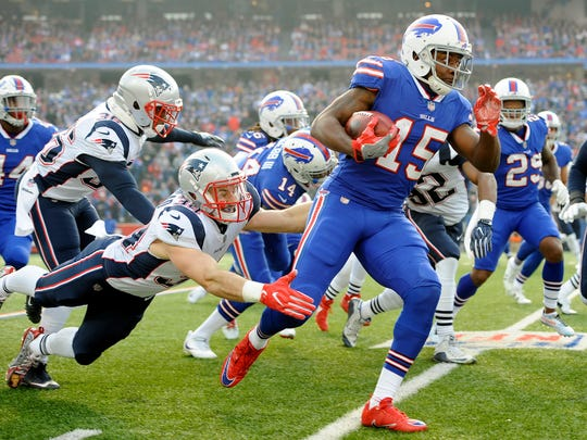 Buffalo Bills' Brandon Tate (15) returns the opening kickoff as New England Patriots' Rex Burkhead (34) tries to stop him during the first half of an NFL football game, Sunday, Dec. 3, 2017, in Orchard Park, N.Y. (AP Photo/Adrian Kraus)