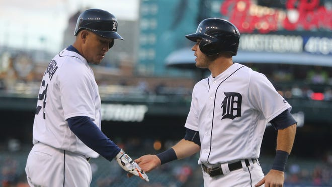 Tigers second baseman Ian Kinsler is met by Miguel Cabrera after scoring during the first inning Wednesday at Comerica Park.