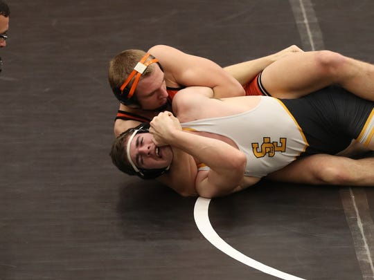 SE Polk's Brady Wenner gets pinned by West Des Moines