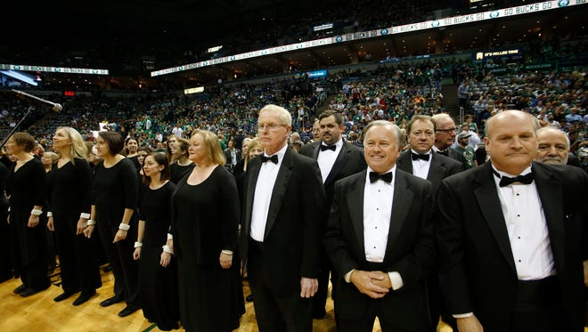 "The Milwaukee Symphony Chorus is having a busy holiday season  in 2018, singing Handel's ""Messiah"" and rehearing for ""The Flying Dutchman"" in January. In this photo, chorus line up to sing at a Milwaukee Bucks game."