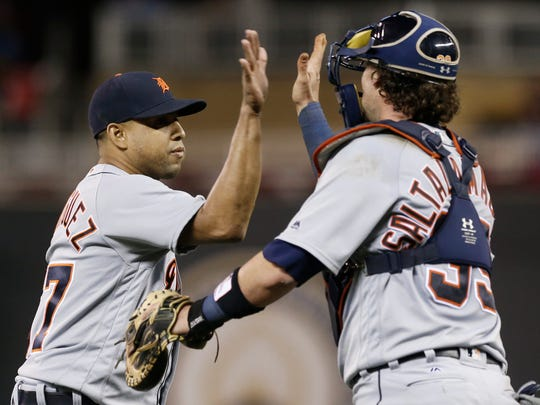 Detroit Tigers pitcher Francisco Rodriguez, left, and catcher Jarrod Saltalamacchia celebrate as the Tigers beat the Minnesota Twins 4-2 in the second game of a baseball doubleheader Thursday, Sept. 22, 2016, in Minneapolis. Rodriguez picked up the save.