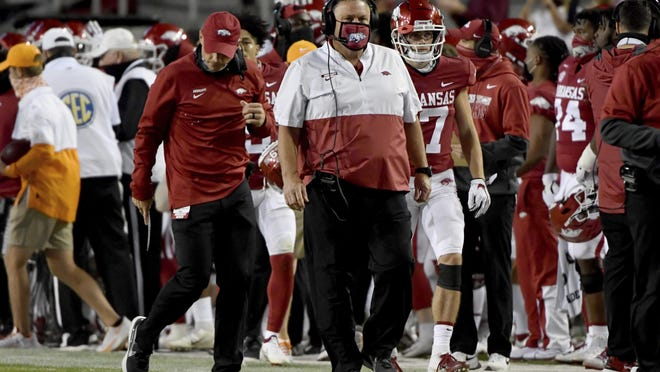 Arkansas coach Sam Pittman walks the sideline during the first half of the team's NCAA college football game against Tennessee on Saturday, Nov. 7, 2020, in Fayetteville. Pittman announced Monday he had tested positive for COVID-19.
