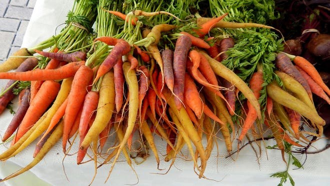 At the now-closed Newbury Park farmers market, multi-colored carrots from the Chavez Farm booth in Ontario can be added to an easy, nutritious and colorful meal for the family during the holiday season.