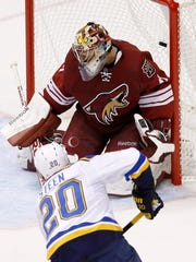 St. Louis Blues' Alexander Steen (20) scores a goal against Arizona Coyotes' Mike Smith during the second period of an NHL hockey game Saturday, Oct. 18, 2014, in Glendale.