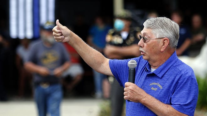 Ashland County Sherrif E. Wayne Risner speaks at the Shield the Line rally on Friday at the Ashland County Fairgrounds.