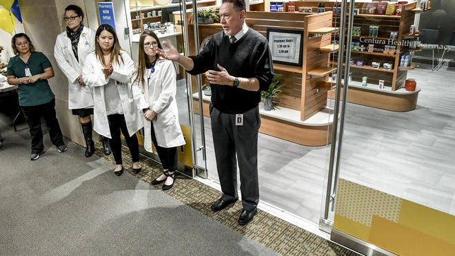 St. Catherine Hospital CEO Scott Taylor, right, talks about Centura Health creating a pharmacy in Siena Medical Clinic in October 2019, during the official opening ceremony for the facility. The pharmacy was dedicated Friday in honor of Taylor, who is retiring July 1.