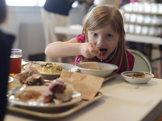 Six-year-old Grace Berry of West York eats a bowl of soup at Healthy World Cafe in the First Moravian Church of York.