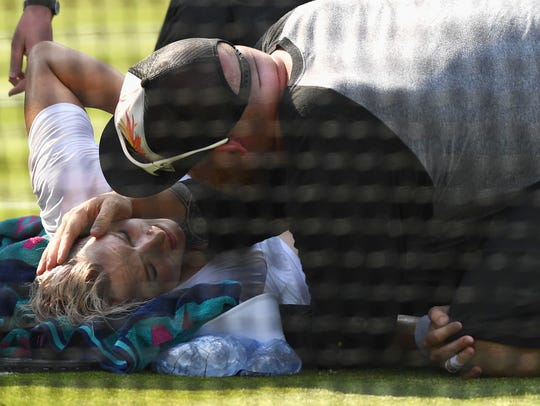 Bethanie Mattek-Sands receives treatment from the medical