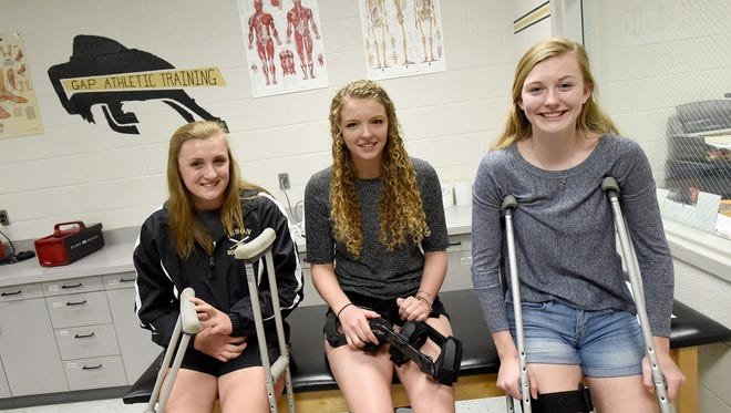 Junior Marybeth Strickler, senior Elizabeth Hanger and junior Hannah Varner of Buffalo Gap High School each sustained ACL injuries while playing basketball this past season. They are photographed in the school's athletic training room on Wednesday, April 5, 2017.