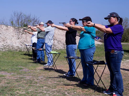 Aransas Pass Independent School District staff take a Texas Handgun Licensing Course at the Schwenke's Rifle & Pistol Range in Aransas Pass given by the Aransas Pass Police Department on Saturday, March 10, 2018. The police department is now expanding its firearms training to all churches.