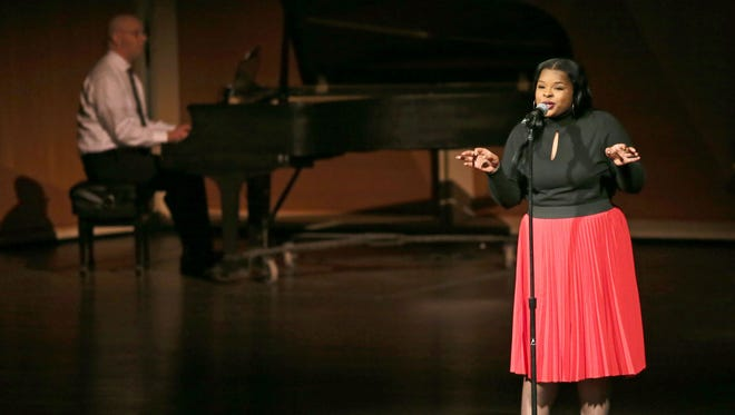 "Kaprice Maxwell, a student at Milwaukee High School of the Arts, sings at the 33rd annual Dr. Martin Luther King Jr. Birthday Celebration at the Marcus Center.  The celebration featured art, writing and speeches around the theme ""We shall overcome."""