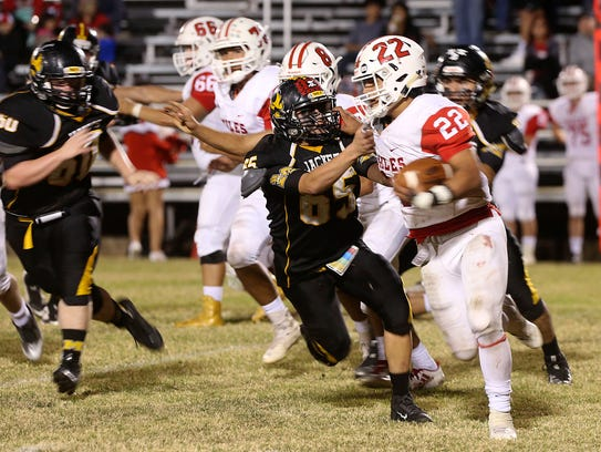 Menard's Quentin Baker tries to tackle Miles' Jonas