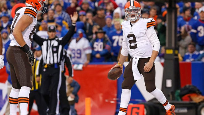 Cleveland Browns quarterback Johnny Manziel (2) celebrates after scoring a touchdown against the Buffalo Bills during the second half at Ralph Wilson Stadium.