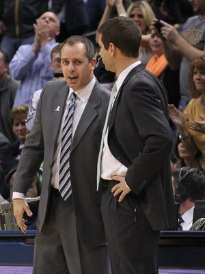 Celtics coach Brad Stevens shakes hands after the game with Pacers coach Frank Vogel at Bankers Life Fieldhouse, March 11, 2014.