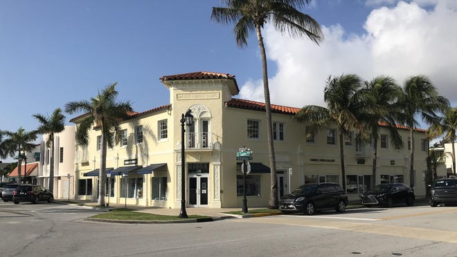 A landmarked Palm Beach building that once housed operations for the Palm Beach Daily News at 214 Brazilian Ave. changed hands for a recorded $8.95 million this week as part of a two-property deal worth $13.33 million. [DARRELL HOFHEINZ/palmbeachdailynews.com