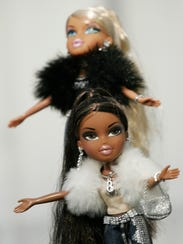 """Bratz were deemed a bit too """"sassy"""" by some parents. But their popularity continued to grow, giving Barbie a run for her money."""