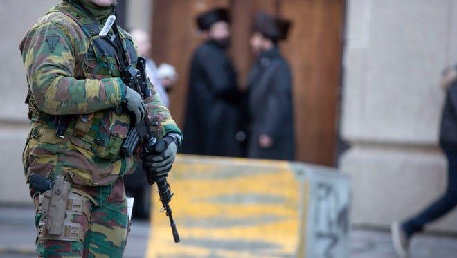 Belgian para-commandos patrol near a synagogue in the center of Antwerp, Belgium, on Jan. 17, 2015.