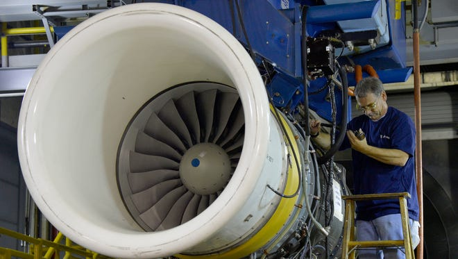 Rolls-Royce employees worked on an engine at Plant No. 5 in Indianapolis in September 2015.