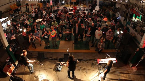 Central Market's food court serves as a concert venue. Here, Kable House Presents hosted one of its acts at the market. The market is increasingly hosting non-traditional events in the evening and weekends. York Storytellers will hold its first night of live storytelling there on March 30.