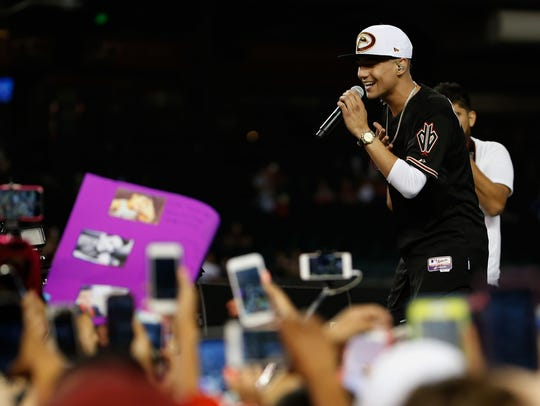 Luis Coronel performs at Chase Field following the