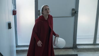 """Offred (Elisabeth Moss) reaches something close to freedom in the Season 2 premiere of """"The Handmaid's Tale."""""""