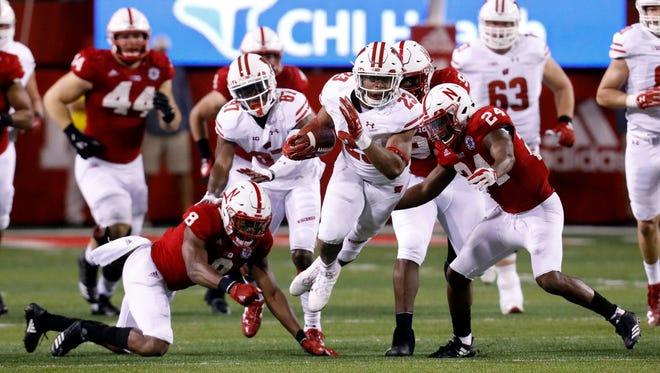 Badgers tailback Jonathon Taylor breaks through for a gain against Nebraska.